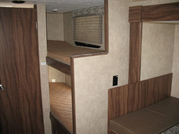 View of the two bunks inside the 2021 Viking 17BHS Bunk House with Slide