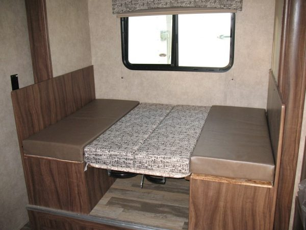Fold down table inside the 2021 Viking 17BHS Bunk House with Slide
