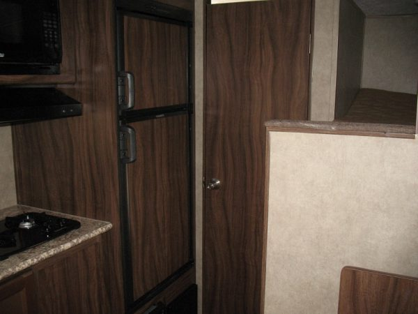 View of the large fridge inside the 2021 Viking 17BHS Bunk House with Slide