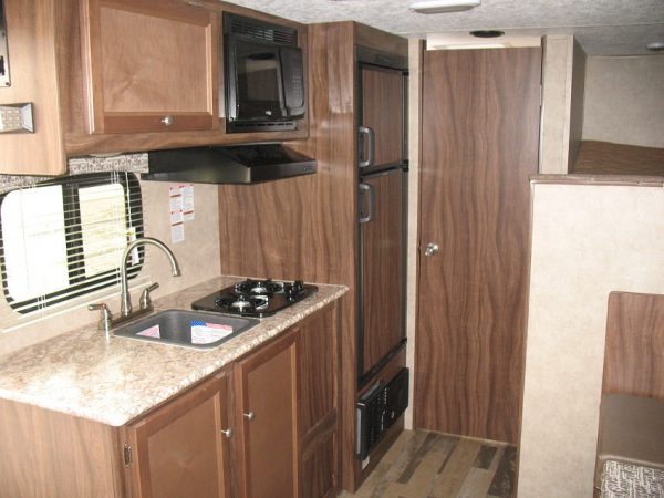 Kitchen area in the 2021 Viking 17BHS Bunk House with Slide