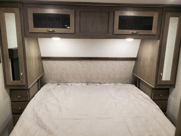 View of the bed inside the 2021 Alta Travel Trailers 2350-KRK Rear Kitchen