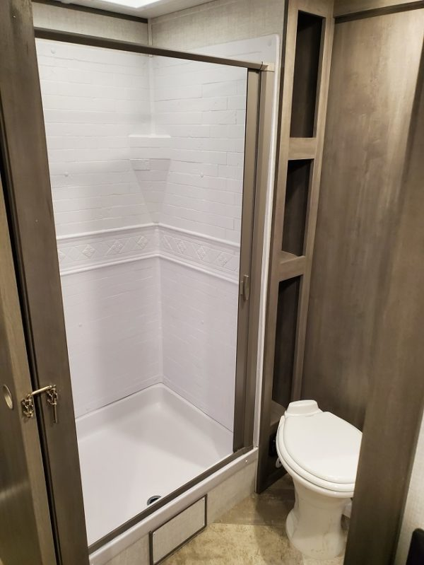 View of the shower in the 2021 Alta Travel Trailers 2350-KRK Rear Kitchen