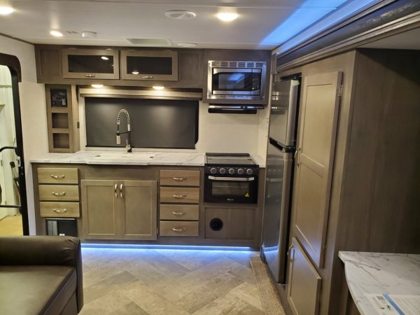 View of the kitchen in the 2021 Alta Travel Trailers 2350-KRK Rear Kitchen