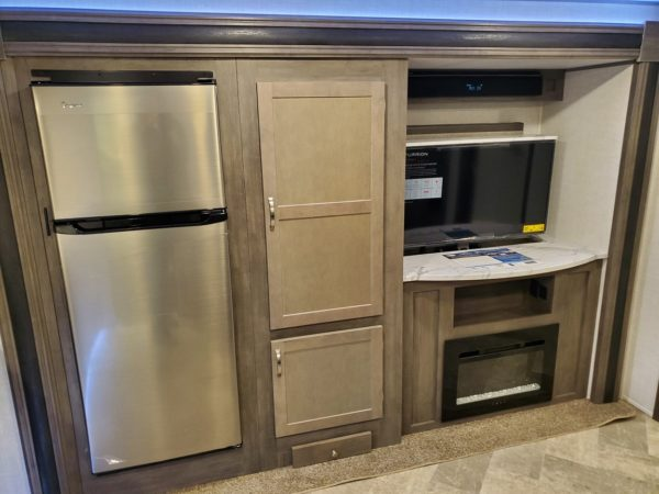 Fridge and Entertainment area in the 2021 Alta Travel Trailers 2350-KRK Rear Kitchen