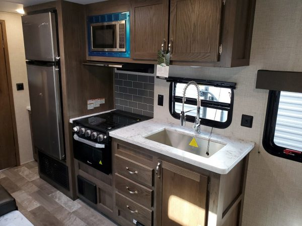 View of the kitchen inside the 2021 Della Terra 250BH - Bunk house with King Front Bed