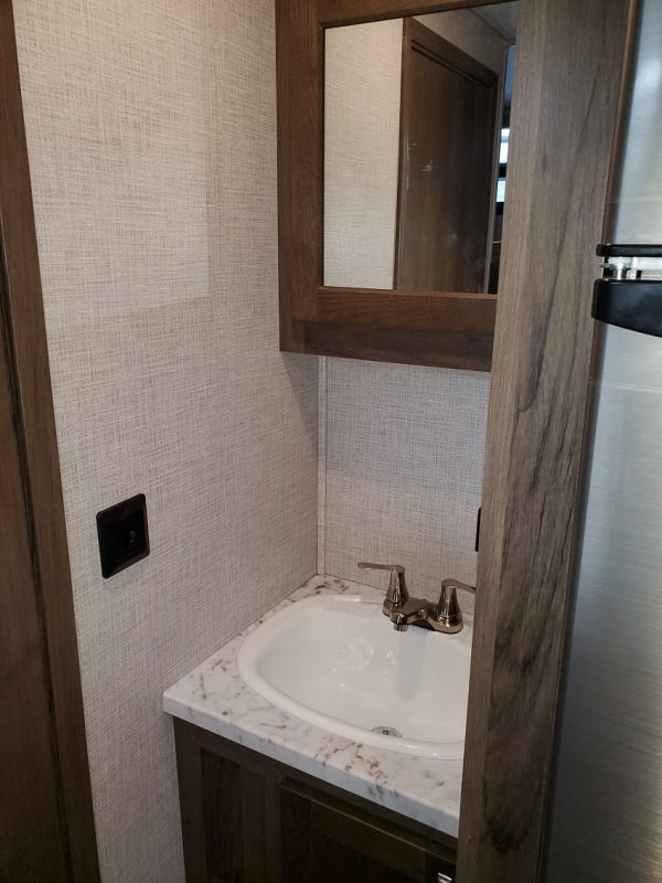View of the bathroom vanity in teh 2021 Della Terra 250BH - Bunk house with King Front Bed