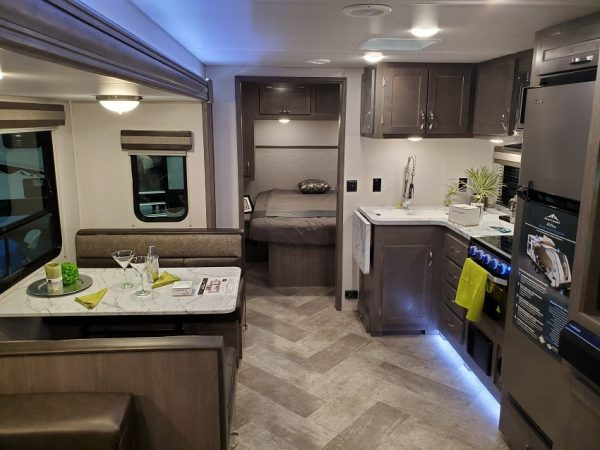 View of the spacious living area inside the 2021 Alta Travel Trailers 2600-KRB Rear Bath