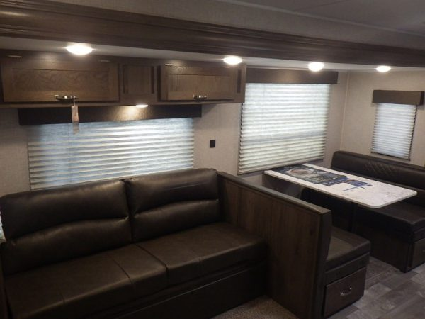 View of the couch and dinette inside the 2020 Della Terra DET261RB Rear Bath