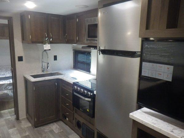 View of the kitchen inside the 2020 Della Terra DET261RB Rear Bath