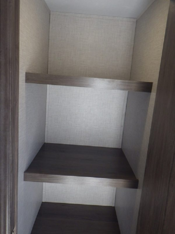 View of the pantry inside the 2020 Della Terra DET261RB Rear Bath