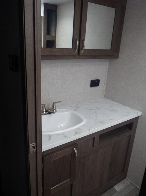 View of the bathroom vanity inside the 2020 Della Terra DET261RB Rear Bath