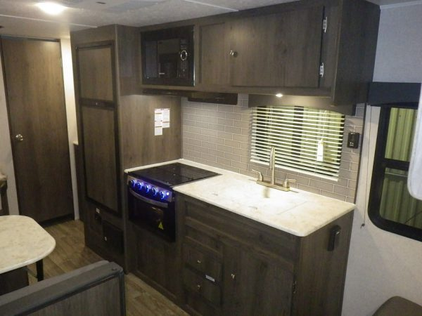 View of the kitchen inside the 2021 Viking 26 Saga Bunk House