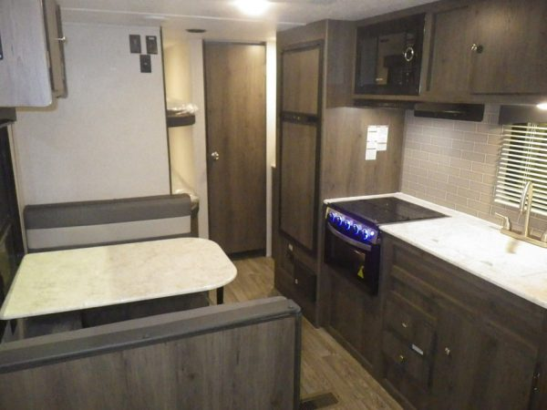 View of the dinette and kitchen area in the 2021 Viking 26 Saga Bunk House