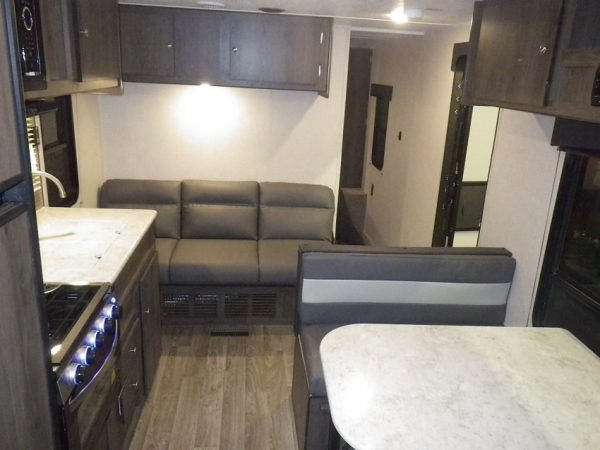 View of the interior living area of the 2021 Viking 26 Saga Bunk House