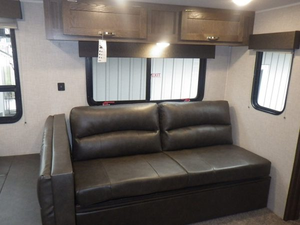 Interior couch in the 2021 Della Terra 271BH Bunk House with Slide