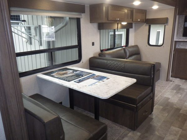 View of the dinette inside the 2021 Della Terra 271BH Bunk House with Slide