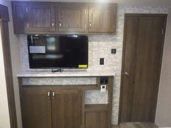 View of the entertainment center inside the 2021 Della Terra 271BH Bunk House with Slide