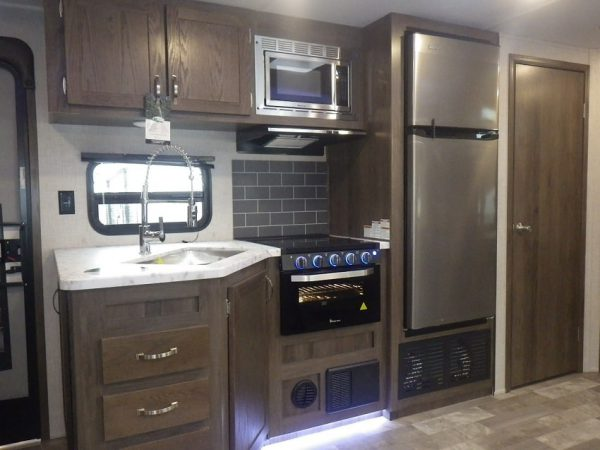 View of the kitchen inside the 2021 Della Terra 271BH Bunk House with Slide