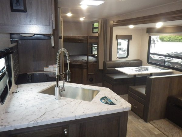 Spacious interior living space inside the 2021 Della Terra 271BH Bunk House with Slide