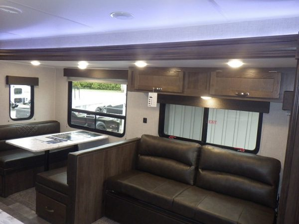 Interior view of both couch and dinette inside the 2021 Della Terra 271BH Bunk House with Slide