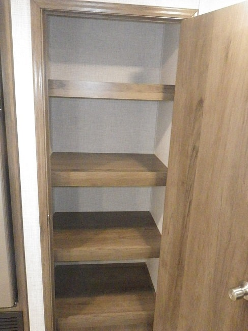 View of the pantry inside the 2021 Della Terra 271BH Bunk House with Slide