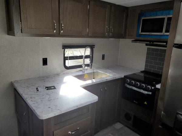View of the kitchen inside the 2021 Della Terra DET291RK