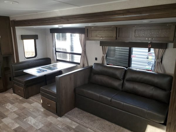 View of the couch and dinette in the 2021 Della Terra DET291RK