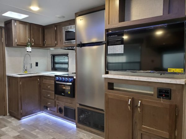 View of the interior kitchen in the 2021 Della Terra 312BH Dual Slide Bunk House