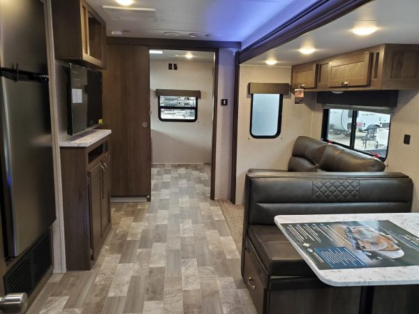 View of the internal living space inside the 2021 Della Terra 312BH Dual Slide Bunk House